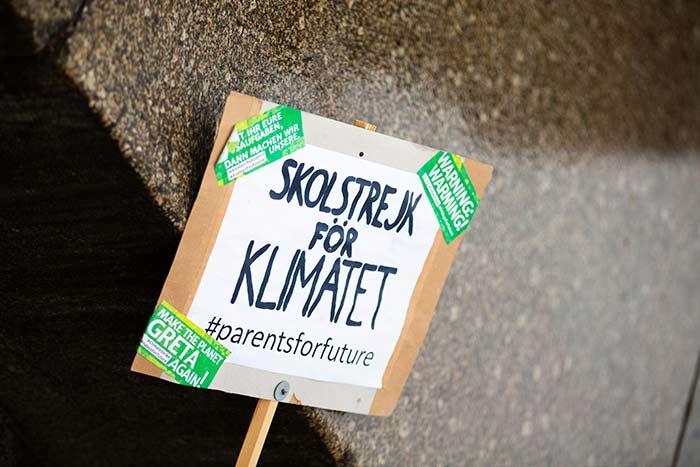climate-change-strike-thinking-heads